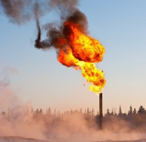 Flares burn off excess methane at an oil and gas field. Credit: Pacific Northwest National Laboratory
