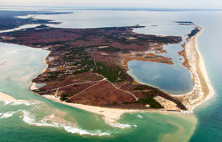 Nantucket Sound's waters flow to the Atlantic through Muskeget Channel, bottom right, with Edgartown, Mass., visible in the distance, upper left. (© Bill Brine/Martha's Vineyard Times)